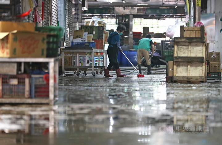 Workers carry out disinfection amid a COVID-19 outbreak.