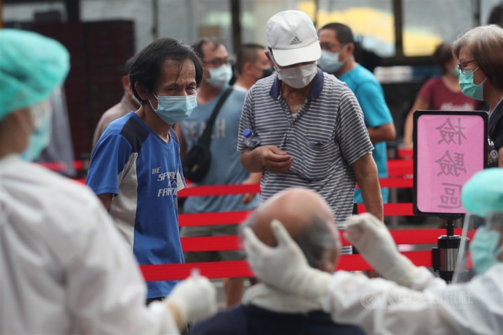 A man is tested at a wholesale market in New Taipei Wednesday. CNA photo June 23, 2021