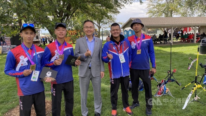 Jerry Chang (center) poses for a group photo with Taiwan's archery team. Photo courtesy of the Taipei Economic and Cultural Office in Denver
