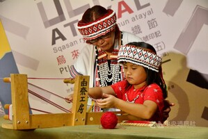 A girl and her grandmother demonstrate traditional Atayal weaving at a cultural festival in New Taipei in October last year.