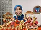 Indonesian artist Fidati (Pindy Windy) with one of her works 'Gamelan.' CNA photo Sept. 26, 2020