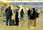 Travelers at Taoyuan International Airport.