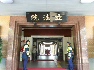Police officers guard an entrance at the Legislative Yuan in Taipei on Jan. 28 last year. / Photo courtesy of Taipei Times